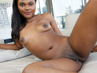Yara is a petite dark mocha babe who who is..