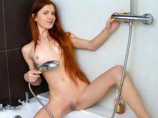 Getting in the shower is tons of fun for redhead..